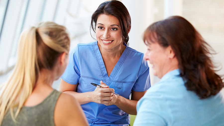 Mother and daughter consulting with daughter's care provider