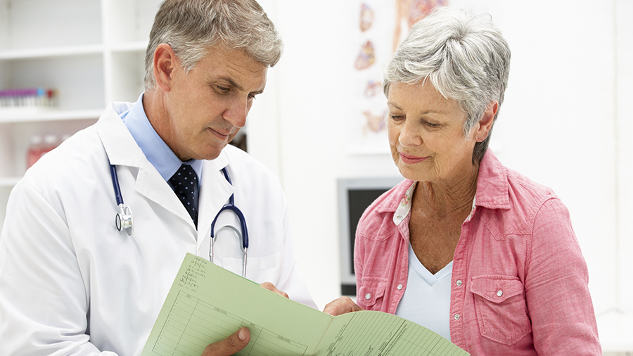 Elderly patient meeting with physician