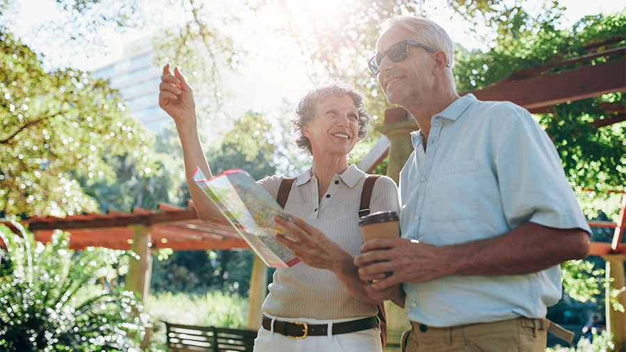 older couple exploring outdoors in the summer