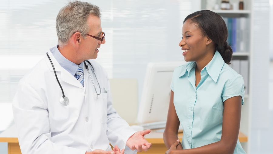 Female patient speaking to a male physician.