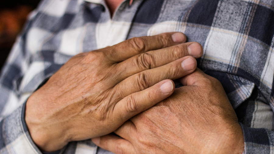 Man clutching chest due to heart pain