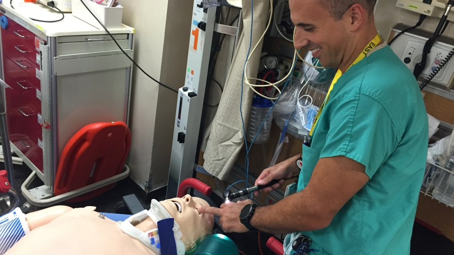 Joseph Ibrahim, MD, working with a dummy patient.