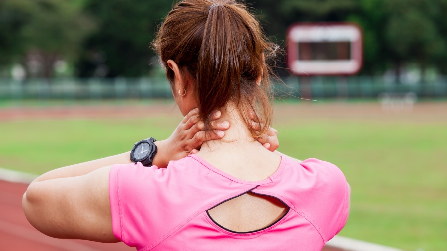 Woman on track with neck pain