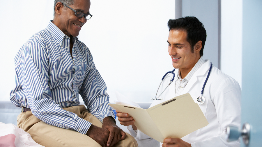 Male patient speaking to doctor about potential treatment options for prostate cancer.