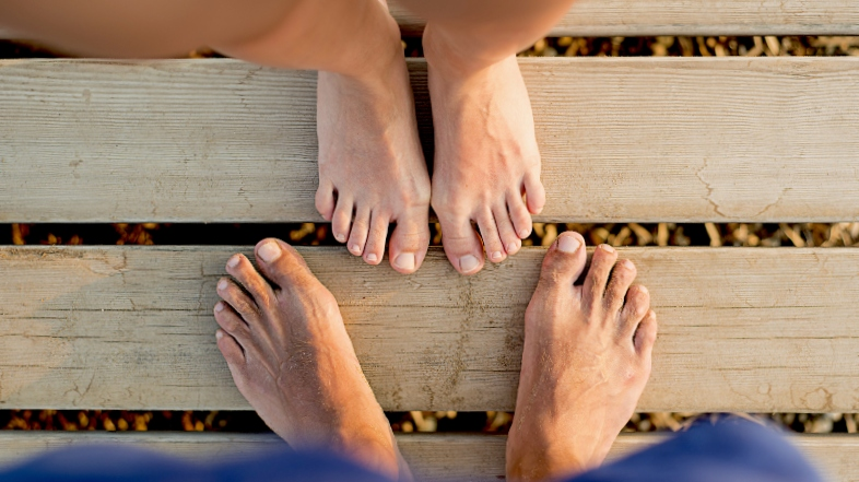 Woman and mans feet