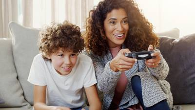 Mom playing a video game with her son