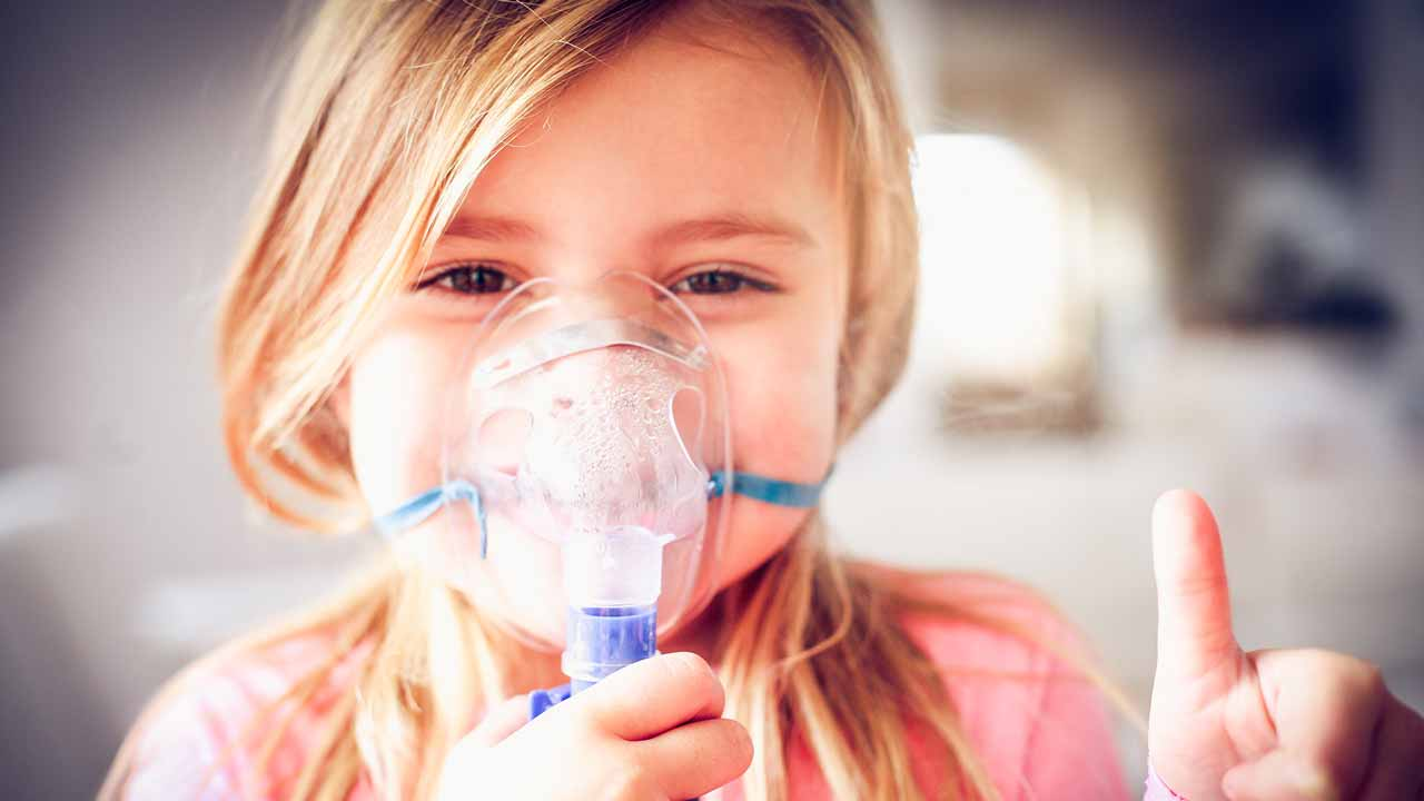 Young girl using a nebulizer