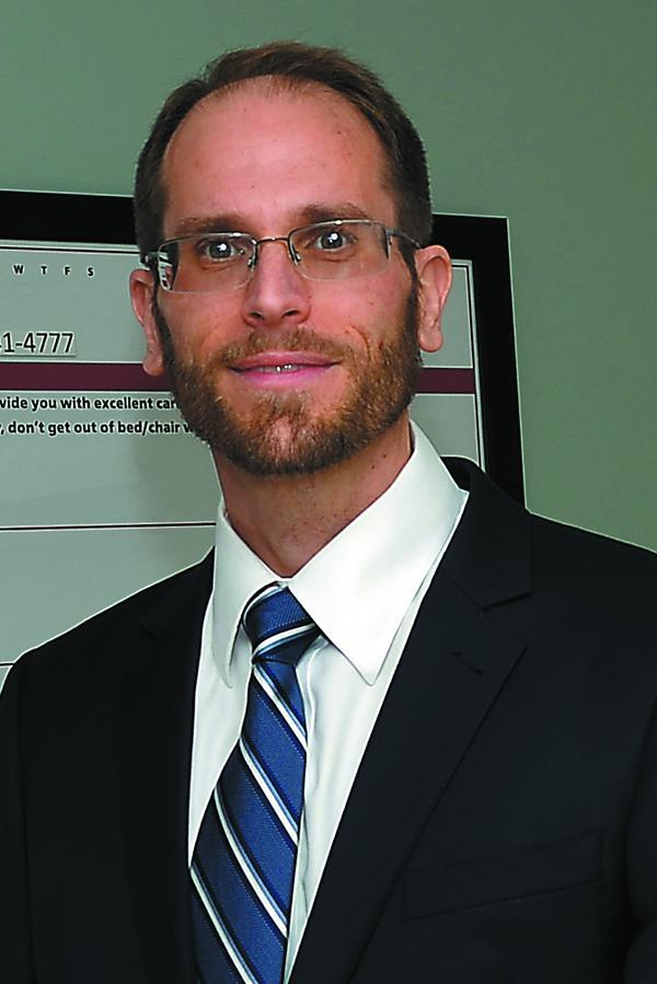 headshot of Eric Alberts