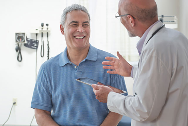 Physician talking to male patient