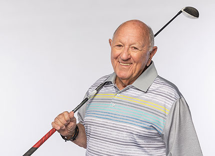 Senior male posing with golf club