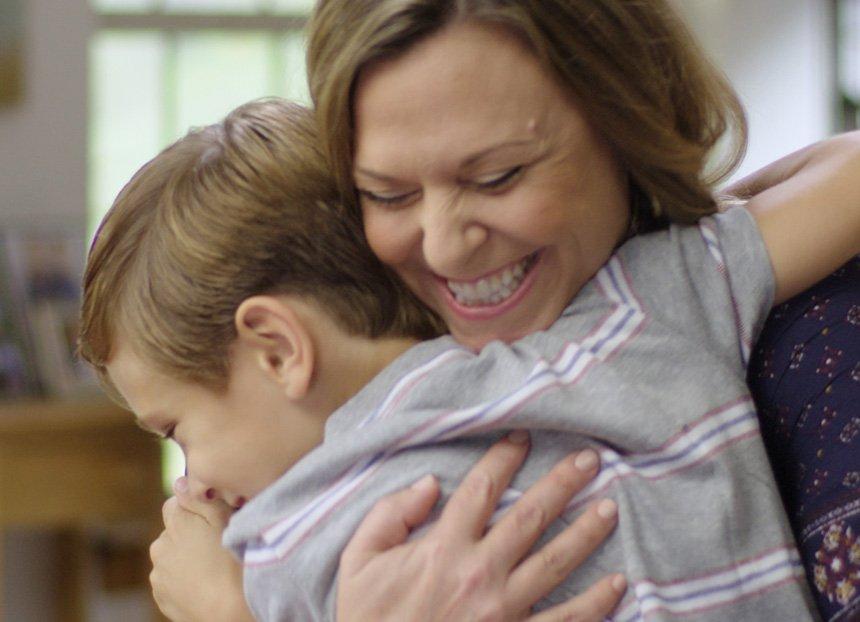 Hilary McFadden hugging her son Landis