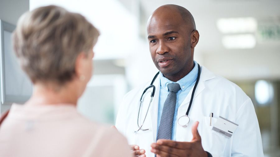 Male doctor explaining results to female patient
