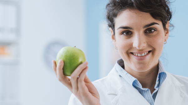 Dietitian holding apple