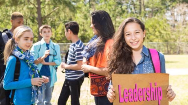 Girl holding leadership sign