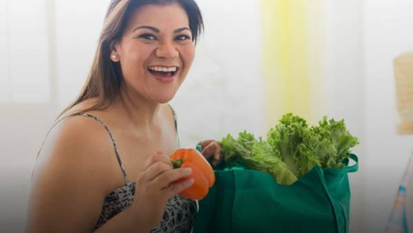 Overweight woman with grocery bag
