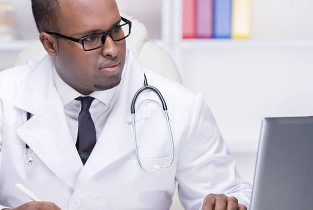 Physician on laptop