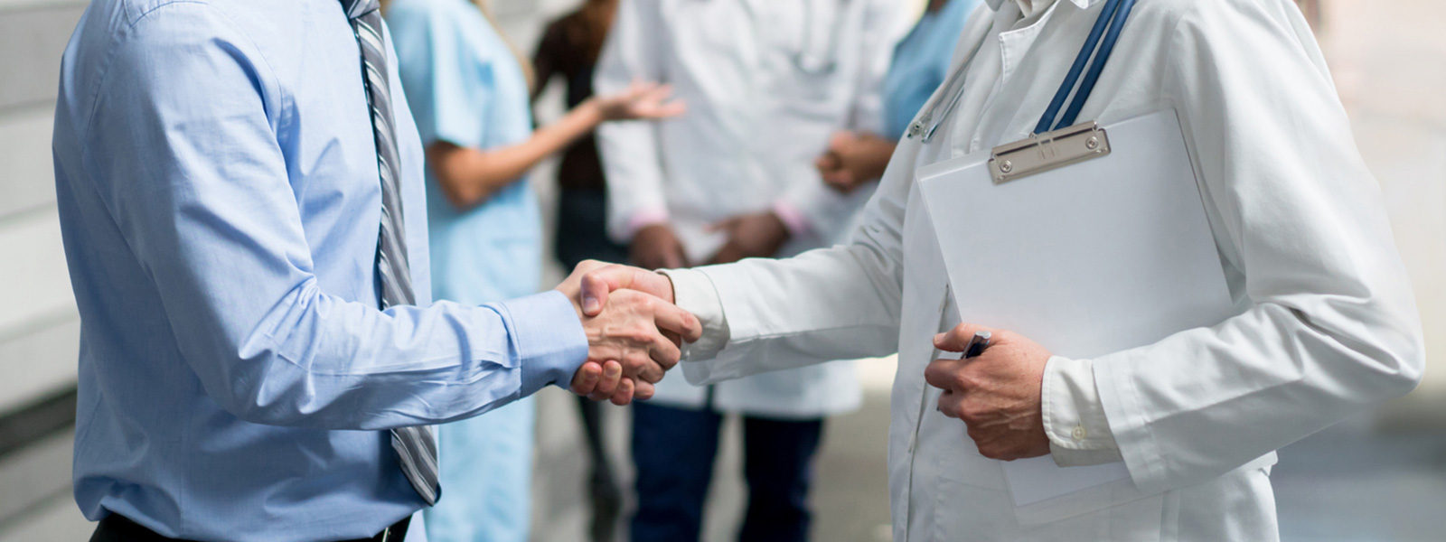 Doctor and insurance agent shaking hands