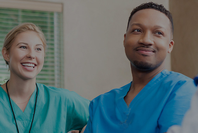 Physicians smiling and talking