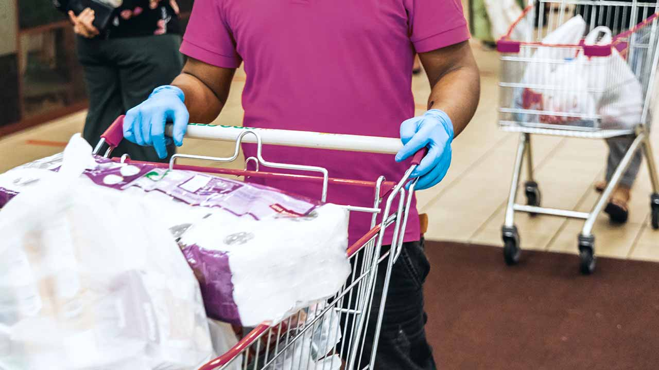 man pushing cart with gloves on