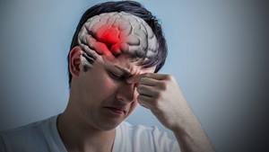 Young man experiencing head pain from stroke.