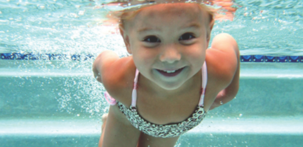 Child swimming underwater.
