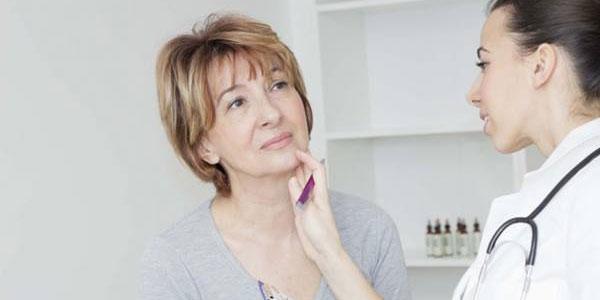 Orlando Health - Doctor Examines Neck Pain