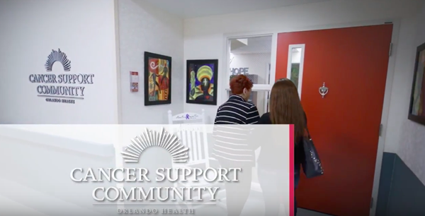 Two women utilizing the resources at the cancer support community.