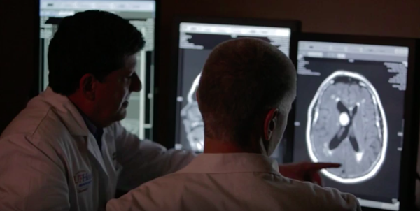 Two doctors reviewing brain scan.
