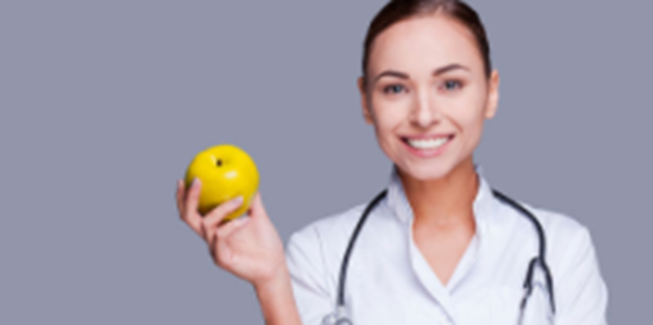 A nutritionist holding an apple.